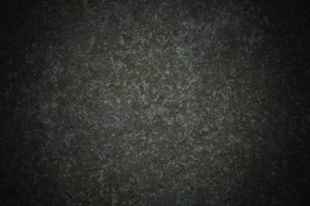 gritty: Dark grey stone background with vignette effect