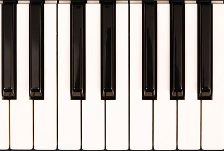 Closeup of piano keys viewed from above photo