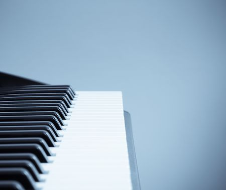 Closeup of a keyboard with copyspace and a cool selenium tone photo