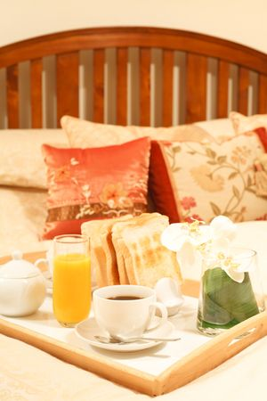overnight stay: Breakfast tray with morning coffee in a luxury bedroom