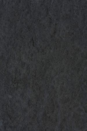 Rough textured background in dark gray stone photo