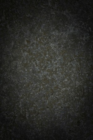 vignetted: Dark gray grungy background with rough texture and vignetting Stock Photo