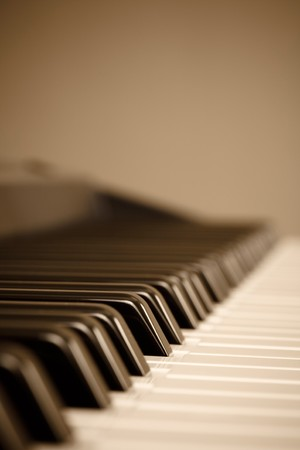 piano closeup: Closeup of a keyboard with copyspace, photo is warm toned for a traditional look