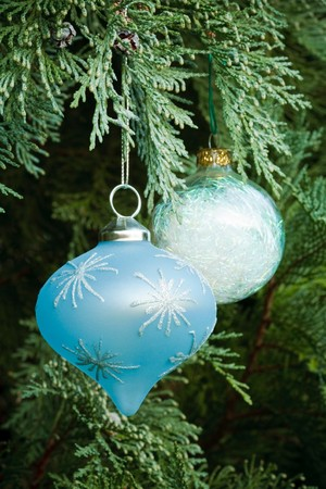 Christmas decorations adorn a real christmas tree Stock Photo - 7919284