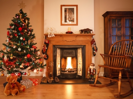 cosy: Traditional living room with a cosy open fire, adorned with christmas decorations and a tree. [Note: Picture above fireplace is photographers own work] Stock Photo