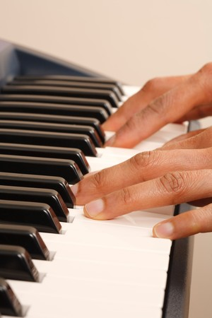 Closeup of a womans hands playing a piano or keyboard photo
