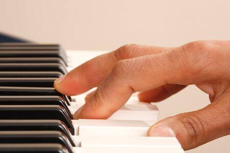 Closeup of a woman playing piano photo