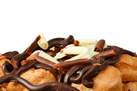 Profiteroles with chocolate isolated against a white background with copy space photo