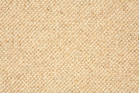rug weaving: Closeup of a textured carpet in beige brown Stock Photo