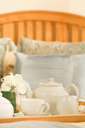 Breakfast tea tray in a luxury hotel bedroom photo