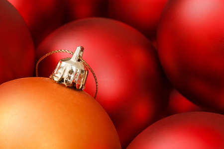 Colorful christmas baubles in red and gold photo