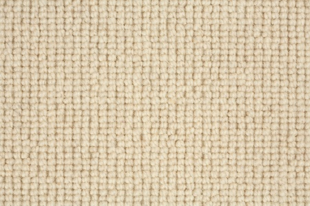 Detail of a loop pile berber carpet in natural colour photo