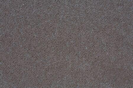 fleck: Deatil de una alfombra gris oscura adecuada para un fondo de textura suave Foto de archivo