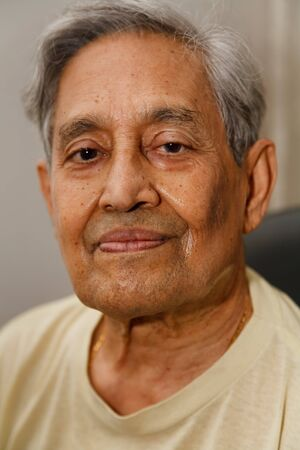 Head only portrait of an Indian senior man with gray hair photo