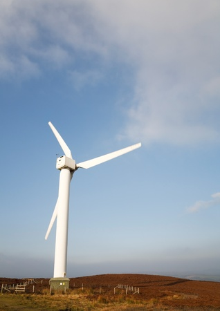 A single wind turbine in British countryside on a sunny day photo