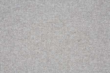 Light grey carpet closeup suitable for a soft textured background photo