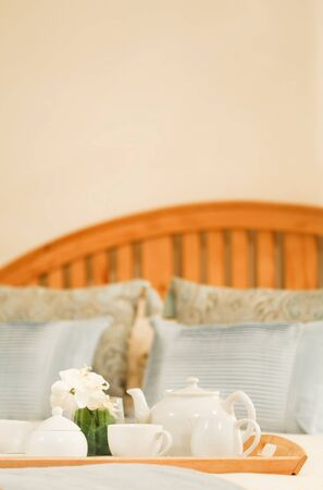 Tea tray on a bed with plenty of copyspace at top photo