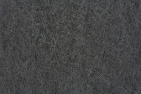 Rough textured background in dark gray stone Stock Photo - 9027515