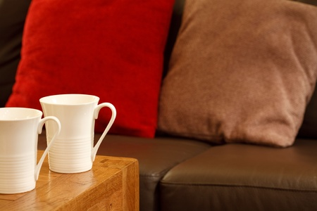 Detail of a stylish coffee house with sofa and mugs. Plenty of space for text photo