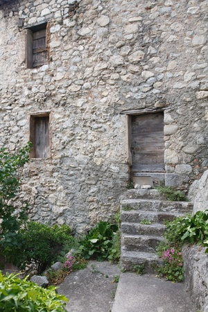 repossessed: Old stone cottage in the historic town of Entrevaux, France Stock Photo