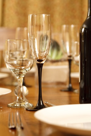 dining out: Dining table with wine glasses and white crockery Stock Photo