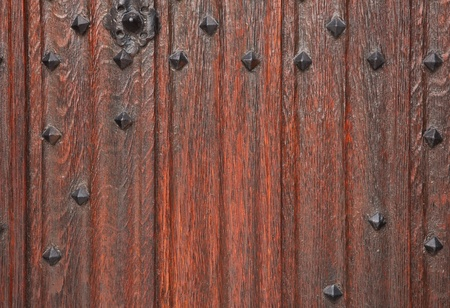 studs: Closeup of a traditional wooden door with cast iron studs
