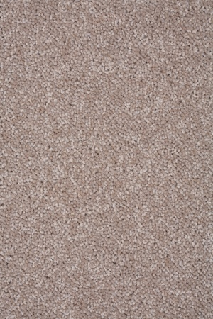 polyester: Closeup of a twist pile carpet in natural brown color