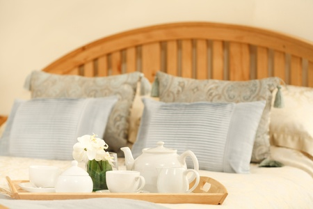 furnished: Breakfast tray on a bed in a traditional style bedroom