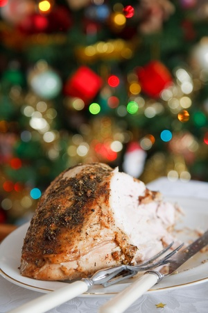 Turkey carvery on a table with a christmas tree in the background Stock Photo - 10550846