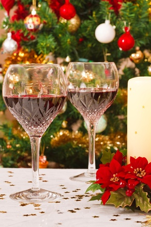 Pair of crystal wine glasses on a christmas table photo