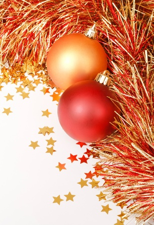 Festive Christmas design with baubles, tinsel and confetti photo