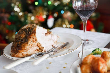 christmas tide: Roast turkey on a table in a festive christmas scene Stock Photo