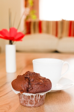parlours: Chocolate muffin on a coffee table in a luxury home interior Stock Photo