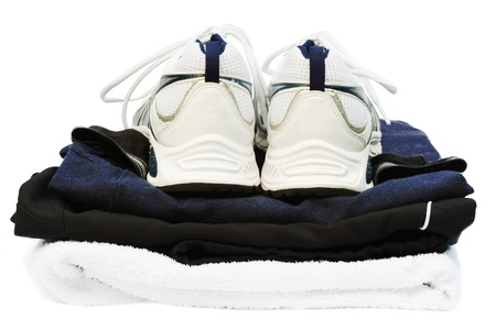 Gym kit with running shoes and towel, isolated against a white background with clipping path photo