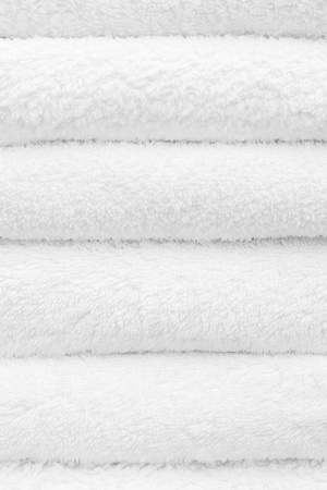 Closeup of a stack of clean white towels photo