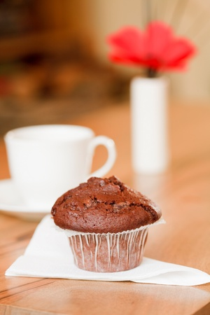 parlours: Breakfast muffin with coffee cup in a cozy home interior Stock Photo