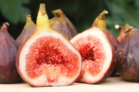 fig tree: Fresh and ripe organic figs with fig leaves in the background