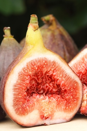 purple fig: Closeup of a freshly cut fig, ideal for depicting healthy eating or organic produce