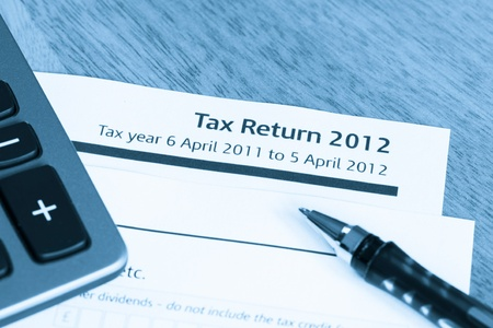 Cool toned image of UK income tax return form for 2012 Banco de Imagens