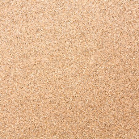 Sand texture closeup ideal for a background or beach theme photo