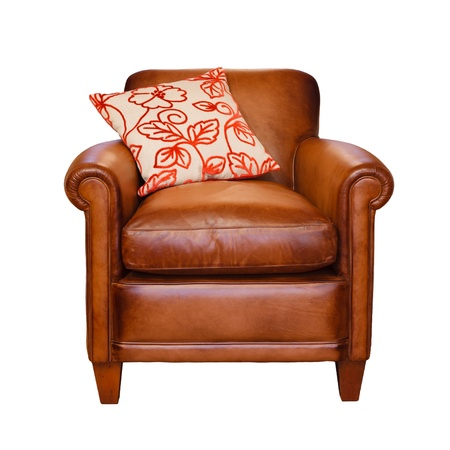 cushion: Leather armchair with trendy cushion on a white background with clipping path
