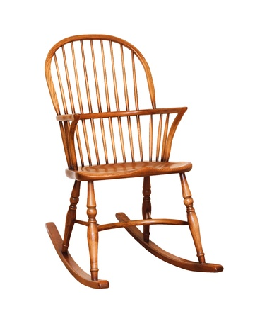 Wooden rocking chair isolated against a white background with clipping path photo
