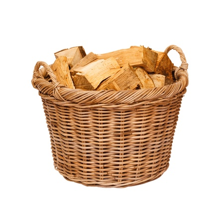 heaped: Traditional wicker log basket with oak logs isolated against a white background