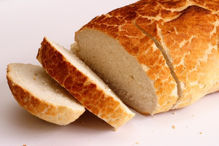 Sliced tiger loaf bread on a white background photo