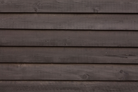 wood textures: Close up of dark brown wooden clapboard Stock Photo