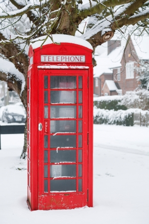 Traditional English phone box in an English village photo