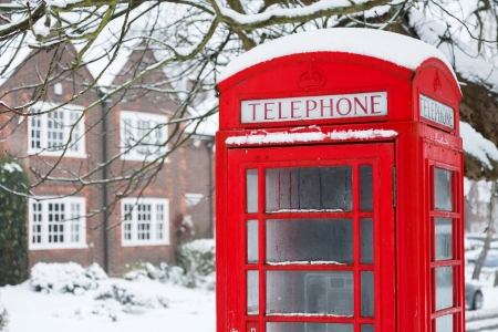 snowscape: Old English red phone box in winter scene Stock Photo