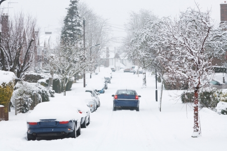Dangerous driving conditions after snowfall in Pinner, UK