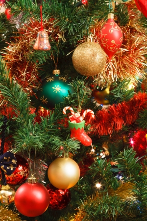many christmas baubles: Christmas tree with colourful baubles and decorations hanging