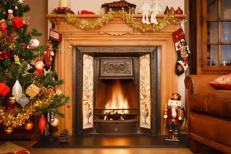 Christmas fire place in a living room photo